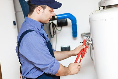 Plumber Working on a Water Heater